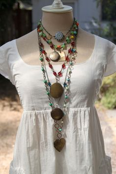 really like this necklace display...a DRESSED sewing mannequin
