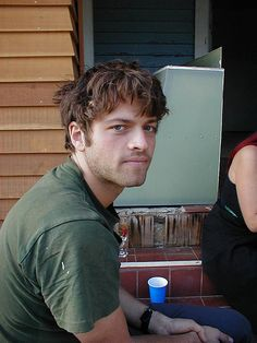 Misha Collins.  Wow, bed head we could look at all day long ;)