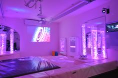 Sensory Magic uses the colours in the projected image to co-ordinate the rest of the room.