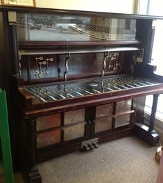 1900 vintage piano made into a computer desk