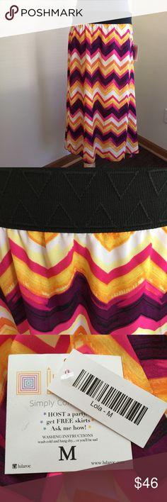 "LuLaRoe Lola midi skirt sz M NWT Gorgeous LuLaRoe ""Lola"" midi skirt, sz M.  Chiffon outer layer over white silky lining.  Elastic waistband.  Length 28.5"", flat waistband 14.5"".  New with tags. LuLaRoe Skirts Midi"