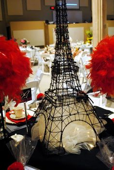 <3 LOVE the tulle and lights under tower... Now where to get the towers? Could alternate table decor between tower, birdcage and Chandelier?
