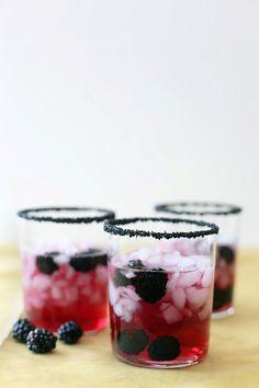 Pomegranate margaritas with blackberries andblack sea salt.