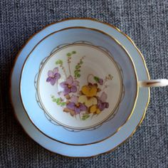 Tuscan Tea Cup and Saucer - Hand Painted Violets - Pale Blue Border with Gold Rim - Wedding Table Setting. I love the blue and the delicate flowers in this tea cup. I think it is a great photographic prop.
