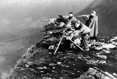 A fascist machine gun squad, backed up by expert riflemen, hold a position along the rugged Huesca front in northern Spain, December 30, 1936. World War II: Before the War - The Atlantic