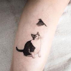 #cattoo cat with bird tattoo