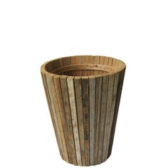 This Scrapwood Vase adds a rustic charm to your favorite bouquet, but can easily stand alone as a decorative piece. Narrow slats of reclaimed Indonesian teak are joined together to vertically create a place to display flowers that's warm and ingenious