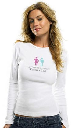 "Newlyweds know that the Beatle's were right when they said it. But now, they can tell the whole world with our ""All You Need Is Love"" Long Sleeve Baby Rib Tee. This super soft and comfy long sleeve tee fits snuggly and sexily to every curve of the bride's body. Each tee is made from 100% preshrunk cotton and features soft ribbing and a cute decal of a man and woman, along with the names of the happy couple. Give this shirt to the blushing bride at her bachelorette party or bridal shower for…"