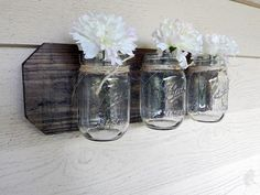 nice stained wall decoration with 3 mason jars Perfect for any room Measurements 18 inches long and 5 1/2 tall    Mounts with 2 keyholes for a secure flat mount.  Flowers and nicknacks and picture not included