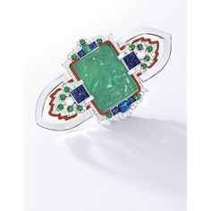 An important Art Deco carved jadeite, diamond, emerald, sapphire, pearl, carved rock crystal, enamel, and platinum brooch, by Cartier, circa 1927.