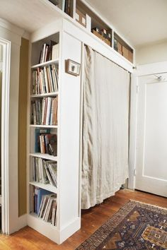 Using a small bookshelf turned outward and a curtain, why not create a closet in a nook or behind a door? ...you could mount a hanging rod across the allotted space and disguise it with a curtain. If the bookcase is not sturdy enough to attach the hanging rack to, simply add a wall-mounted rod, like this one from Improvements. Adding a piece of crown molding in front of the curtain adds to the built-in appeal, and you can customize the size according to your space.