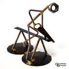 Carpenter Wirecraft Figure - I love this piece! Simple and to the point, it features a carpenter or handyman busy sawing a board. Everyone can relate to this very practical gift idea.