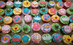 Alice in Wonderland cupcakes! Tea cups, Mad Hatter, Queen of Hearts, Eat Me, Cheshire the cat, flowers, crowns and clocks! White cake with a cream cheese filling.