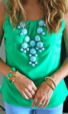 I love, love, love this tank (that color) and the green/turquoise combo is amazing. But that necklace is so not me.
