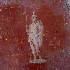 'Remain'   Grafitti on a fresco, Pompeii, Italy. 2011 © Incognita Nom de Plume