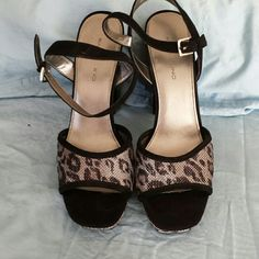 Bandolino animal print platform shoe These are just crazy good black with a silver cheetah print I did wear these once so comfortable  4.5 in.heel with a 1 in platform ..u don't feel the height wonderful shoe Bandolino Shoes Platforms