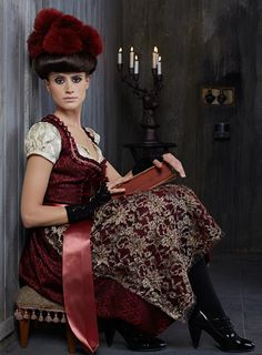 A Trentini dirndl ensemble done up in rich, endlessly gorgeous hues of taupe and rich burgundy. #German #dress #Austrian #dirndl #hat #folk #costume