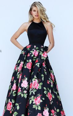 Surprise the crowd in Sherri Hill 50333. Scoop neckline with solid fabric composed the fitted top. Floral print overlaid the full skirt creating a graceful appeal.