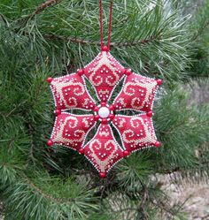 A Snowflake . Biscornu Cross Stitch, Xmas Cross Stitch, Cross Stitch Charts, Cross Stitch Designs, Cross Stitching, Cross Stitch Embroidery, Cross Stitch Patterns, Embroidered Christmas Ornaments, Handmade Christmas Tree