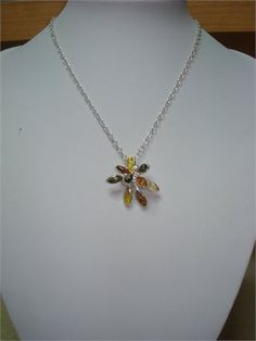 amber baltic flower design pendant, in sterling silver 925, at 1 inch long and 1 inch tall, it comes with a sterling silver chain at 50 cm long