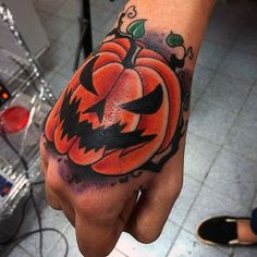Scary Halloween tattoo design. The design features a scary looking pumpkin that is laughing evilly at the thought that Halloween is just around the corner.