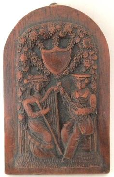 Springerle cookie mold: wax, woman and man playing musical instruments (harp and lute)