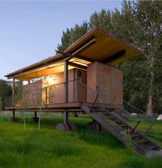 Architects: Olson Sundberg Kundig Allen (OSKA) Architects, location: Mazama, Washington, USA. 440 sf/per hut (200 sf interior space, 240 sf exterior deck). The structures able to roll into and set up on the site. The roof is a butterfly roof for water conservation, a new design vernacular we are seeing more of. The gigantic wheels lift the structures well above the meadow, keeping the footprint of each hut to the barest minimum, making for a low-tech and low-impact design.