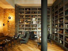 The Wythe Hotel, Brooklyn NY | amazing floor to ceiling lawyer's cabinet bookshelves. light by Workstead.