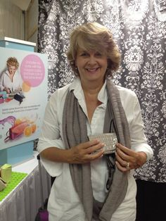 Card Cubby founder Wendy Krepak trying out a Clutch Wrap purse by SHOLDIT! The Card Cubby fits perfect! Atlanta Gift Show 2013