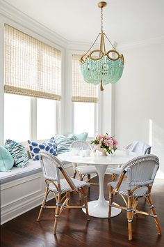 bench, beaded chandelier, café chairs