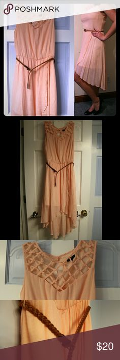 Pale Pink Flowing Dress Flowing pink dress with beautiful criss-cross pattern across chest. Comes with brown braided belt. Only worn once to a wedding and it was really beautiful! Lily Rose Dresses High Low