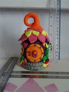 Hobbit House - Night Light (battery operated tea light) a purple, orange, pink and multicolured polymer clay hobbit house with an internal glass jar as a base. Hobbit Door, The Hobbit, Orange Pink, Purple, House Lift, Battery Operated Tea Lights, Leaf Shapes, Glass Jars, Bunting