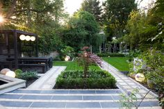 The garden has been loosely based on a Japanese style garden with simple lines and repetition. A paved area directly at the top of the terrace allows option for a table and chairs to be placed on it for formal dining. Two pathways lead off from this area.#patio #japanesegarden #lawn #london
