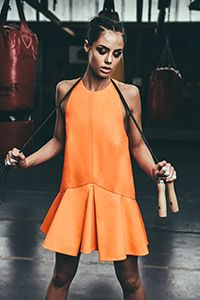 Not sure if this sporty orange fashion dress will come in handy when working-out.. Still, this is a beautiful picture. #Fitgirlcode