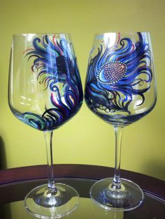 """Chelsi Lees Designs  Hand Painted Peacock Feather Blue-Black-Multicolor  Peacock Hand Painted wine glass  Chelsi Lees Designs on ETSY    Also, please visit & """"Like"""" Chelsi Lees Designs at: http://www.facebook.com/CLdesigns"""