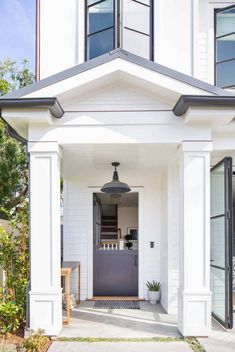 A family's dream home built from the ground up in Corona del Mar is complete with eclectic furnishings and personalized finishing touches making this one happy place to be. Build: Graystone C… Front Door Paint Colors, Painted Front Doors, Farmhouse Homes, Modern Farmhouse, Farmhouse Design, Brick Accent Walls, Custom Builders, Transitional Decor, Transitional Kitchen