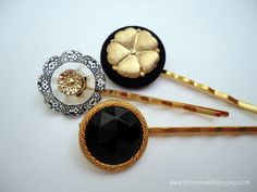 Black and gold vintage buttons, handset on gold bobby pins.
