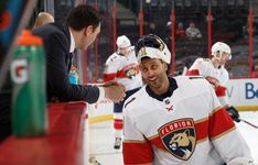 OTTAWA, ON - MARCH 29: Roberto Luongo #1 of the Florida Panthers talks with television analyst Jamie McLennan during warmup prior to a game against the Ottawa Senators at Canadian Tire Centre on March 29, 2018 in Ottawa, Ontario, Canada. (Photo by Andre Ringuette/NHLI via Getty Images)