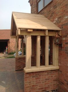 Oak porch hand made by. www.Bespoaktimberframes.co.uk