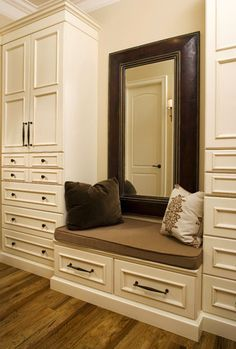 A seat with mirror behind ? Must be flush to the closet.... (this is a crappy example, but gives the idea)