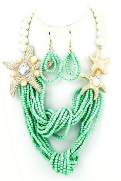 GINA NECKLACE- starfish necklace featuring knotted seed beads and beaded pearls.