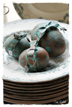 Easter eggs dappled in chocolate brown and turquoise blue. Tiny silver charms are also tied into the additional hand-painted ribbons.