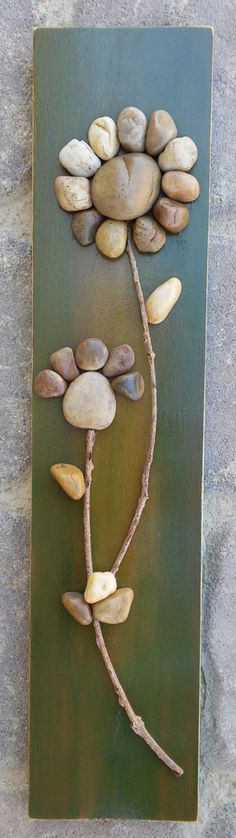Pebble Art / Rock Art Flower on reclaimed wood, approx. 15.5x3.5 (FREE SHIPPING) by CrawfordBunch on Etsy https://www.etsy.com/listing/242755516/pebble-art-rock-art-flower-on-reclaimed