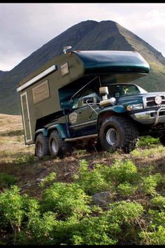 Wow, a Ram truck 6x6?  Check out the slick camper and monster tires on this!