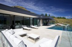 Shotover House by Gary Todd Architecture Concrete Cladding, Concrete Floors, Aluminium Joinery, Mountain Home Exterior, Snug Room, Polished Concrete, Entry Foyer, Pool Designs, Architecture Design