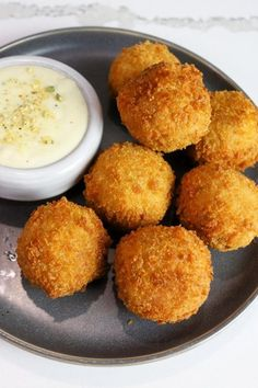 Just when you thought fried mac and cheese couldn't get any better. These Bacon Mac & Cheese Bites are filled with our hearty bacon mac and cheese brats, beer, and cream cheese, then breaded and fried to crispy perfection. Fried Mac And Cheese, Mac And Cheese Bites, Mac Cheese, Appetizer Recipes, Appetizers, Bratwurst Recipes, Sausage, Fries, Beer
