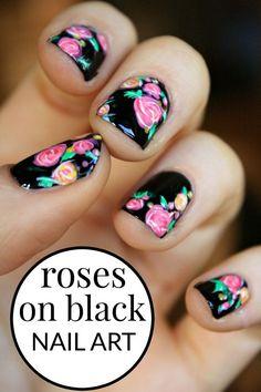Beautiful roses on black nail art design