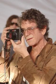 Lou Reed and Leica, camera, a man and his camera, glasses, hands, focus, concentration, portrait, photography