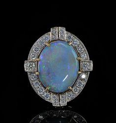 Art Deco opal and diamond ring circa 30s-40s.