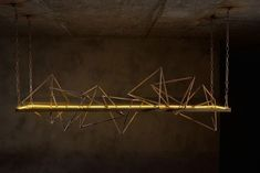 Triangular and pyramidal shapes create a stunning lighting fixture